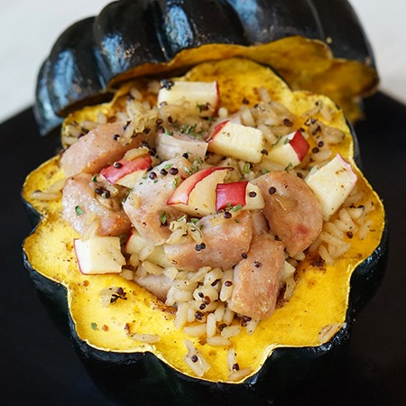 Chicken Sausage and apple stuffed acorn squash on a serving dish
