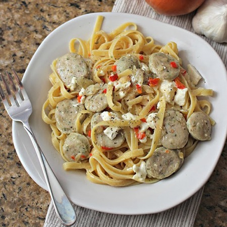 Creamy feta and chicken sausage fettucine on a plate with fork