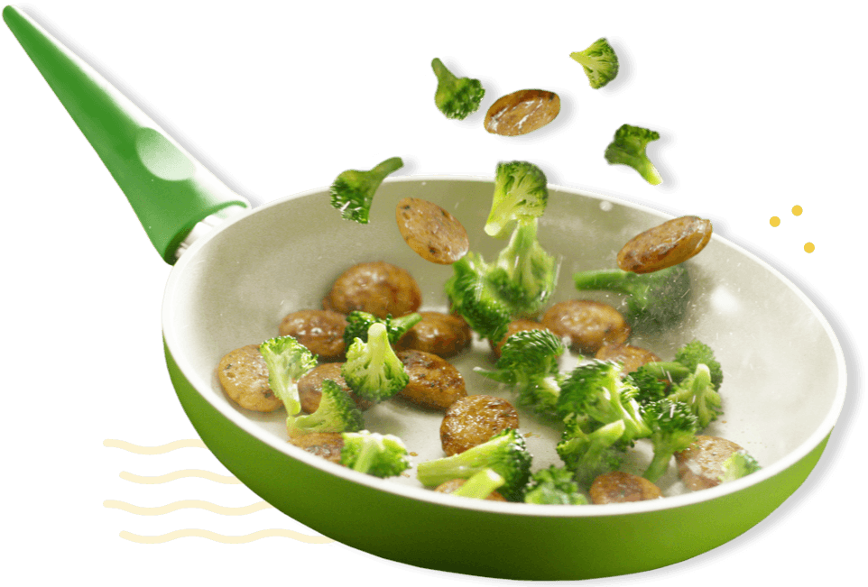 Chicken sausage and broccoli in a frying pan