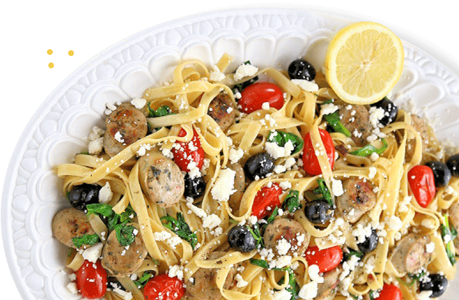 Chicken sausage, olives, tomatoes, feta cheese over linguine